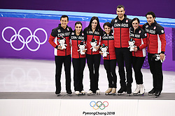 PYEONGCHANG, Feb. 12, 2018  Team Canada pose for group photos after winning the figure skating team event at the 2018 PyeongChang Winter Olympic Games, in Gangneung Ice Arena, South Korea, on Feb. 12, 2018. Canada won the gold medal with 73 points in total. (Credit Image: © Ju Huanzong/Xinhua via ZUMA Wire)