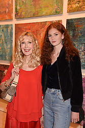 Left to right, Basia Briggs and Lizzie Mawson at a preview of an exhibition of art by Sassan Behnam-Bakhtiar entitled 'Oneness Wholeness' held at the Saatchi Gallery, Duke of York's HQ, King's Rd, London, England. 14 May 2018.