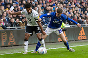 Gavin Whyte of Cardiff City challenges Wayne Routledge of Swansea City during the EFL Sky Bet Championship match between Cardiff City and Swansea City at the Cardiff City Stadium, Cardiff, Wales on 12 January 2020.