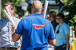 May 28, 2017 - MüNchen, Bayern, Germany - A skinhead wears an Alternativ fuer Deutschland (far-right) t-shirt outside an event in Trudering, where Angela Merkel held a speech. (Credit Image: © Sachelle Babbar via ZUMA Wire)