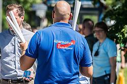 May 28, 2017 - MüNchen, Bayern, Germany - A skinhead wears an Alternativ fuer Deutschland (far-right) t-shirt outside an event in Trudering, where Angela Merkel held a speech. (Credit Image: © Sachelle Babbar via ZUMA Wire)