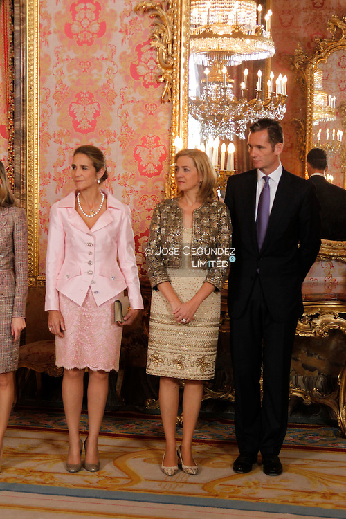 Spanish King Juan Carlos, Queen Sofia, Prince Felipe of Spain, Princess Letizia of Spain, Princess Elena, Princess Cristina and Inaqui Urdangarin attend the National Day Military Parade on October 12, 2011 in Madrid, Spain.