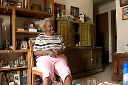 07 Oct, 2005.  New Orleans, Louisiana.  Hurricane Katrina aftermath. <br /> 81 year old Rosella McKoy sits in stunned silence looking around her home in the projects which was miraculously  spared by the floods.<br /> Photo; ©Charlie Varley/varleypix.com