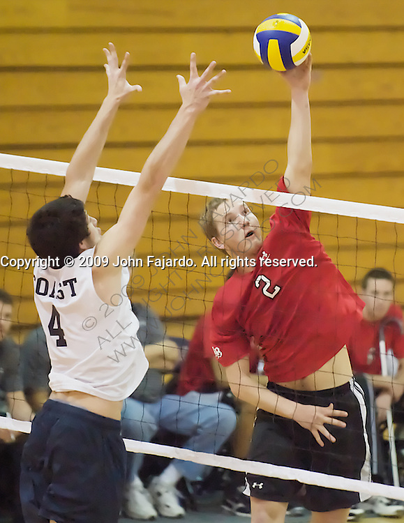 20Feb09 Costa Mesa, CA-  Long Beach City College Setter Chuck Chamberlain tries a sneak attack on the Orange Coast College block put up by Jake Melone.  LBCC loses on the road at OCC 3-2.