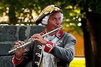 A flute player in historical costume, Sanssouci Palace, Sanssouci Park (a UNESCO World Heritage site), Potsdam, Germany