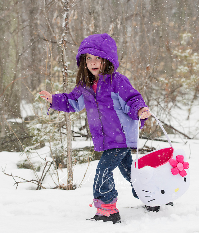 Emma Sylvestre sets out with Easter basket in search of eggs at the Weirs Community Park Easter Egg Hunt on Saturday morning.  (Karen Bobotas/for the Laconia Daily Sun)