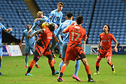 Coventry City midfielder Tom Bayliss (30) beats Wycombe Wanderers striker Adebayo Akinfenwa (20) to the ball 0-0 during the EFL Sky Bet League 2 match between Coventry City and Wycombe Wanderers at the Ricoh Arena, Coventry, England on 22 December 2017. Photo by Alan Franklin.