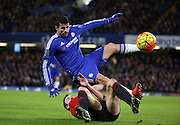West Brom defender Jonny Evans going through Chelsea striker Diego Costa during the Barclays Premier League match between Chelsea and West Bromwich Albion at Stamford Bridge, London, England on 13 January 2016. Photo by Matthew Redman.