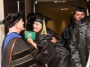 Nicolette Lacich hugs her College of Business Assistant Professor Rachida Aissaoui following spring undergraduate commencement. Photo by Ben Siegel