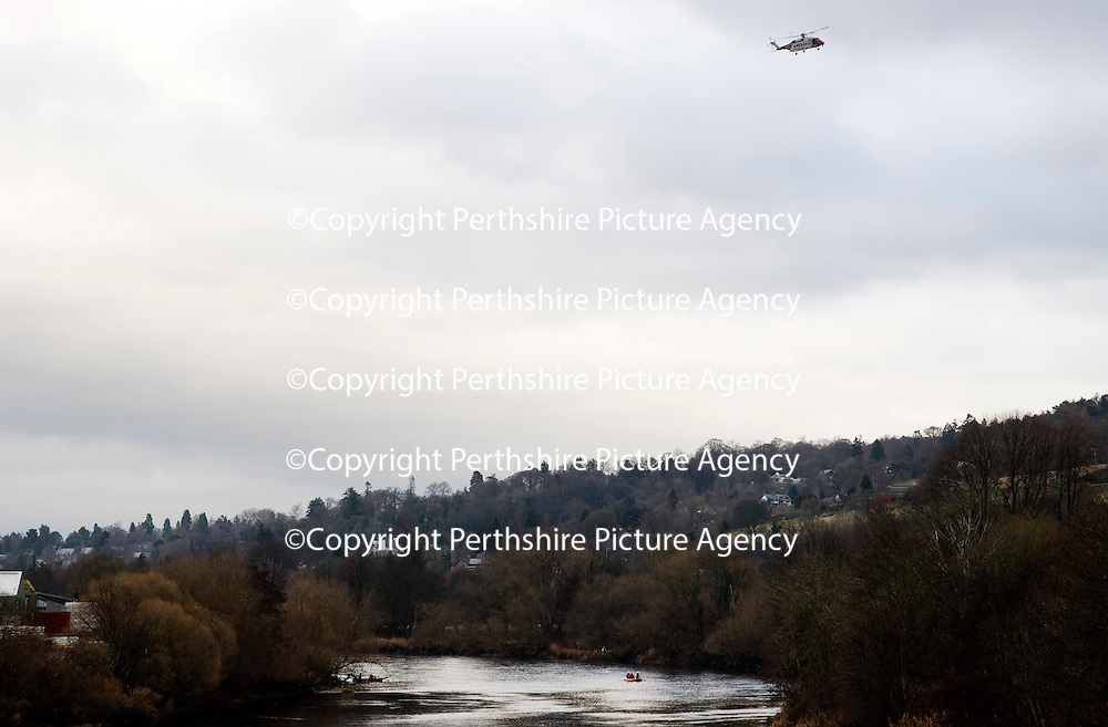 Searches continue in River Tay following concern for man in water, Perth….20.12.16<br />Police, Coastguard helicopter and Firefighters in Perth searching the River Tay after a report of a man in the water at about 9.05pm yesterday evening (19.12.16) The man is believed to be vulnerable missing 20-year-old Iain Guthrie from Perth who was reported missing at 9.50pm last night..<br />Picture by Graeme Hart.<br />Copyright Perthshire Picture Agency<br />Tel: 01738 623350  Mobile: 07990 594431