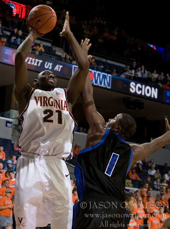 Virginia Cavaliers center Tunji Soroye (21) shoots over Longwood Lancers forward Clayton Morgan (1).  The Virginia Cavaliers Men's Basketball Team defeated Longwood University 90-49 at the John Paul Jones Arena in Charlottesville, VA on February 13, 2007.