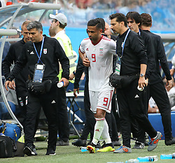 SAINT PETERSBURG, June 15, 2018  Iran's Omid Ebrahimi (C) leaves the pitch after his injury during a group B match between Morocco and Iran at the 2018 FIFA World Cup in Saint Petersburg, Russia, June 15, 2018. (Credit Image: © Lu Jinbo/Xinhua via ZUMA Wire)
