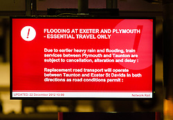 © Licensed to London News Pictures. 22/12/2012. London, UK. A sign in Paddington Railway Station warns that rail services to the South West of England are disrupted due to heavy rain and flooding in the South West of England. Photo credit : Richard Isaac/LNP