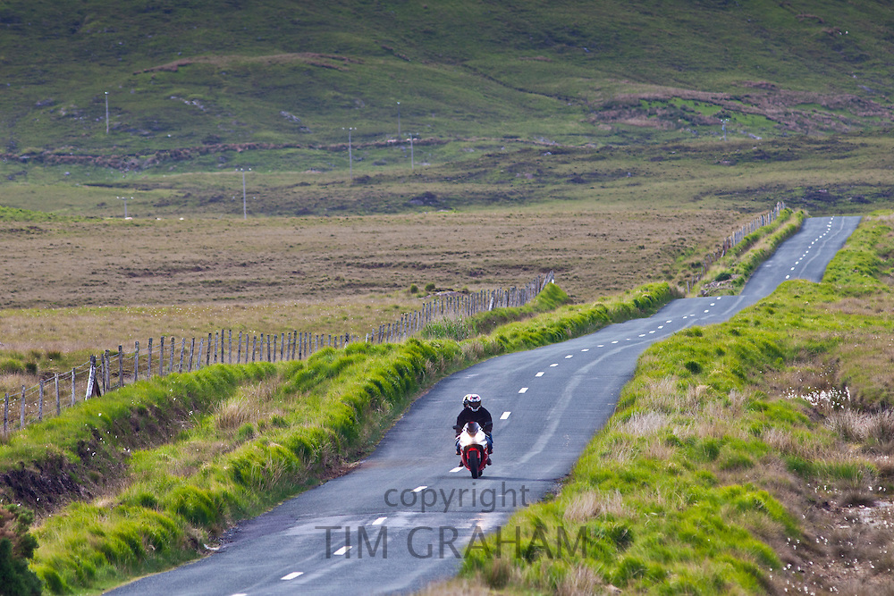Motorcyclist on Kylemore Pass in Connemara National Park, County Galway, Ireland