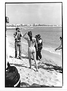 Topless woman being phootographed, Cannes Film Festival 1995© Copyright Photograph by Dafydd Jones 66 Stockwell Park Rd. London SW9 0DA Tel 020 7733 0108 www.dafjones.com