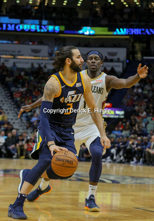 Mar 11, 2018; New Orleans, LA, USA; Utah Jazz guard Ricky Rubio (3) drives past New Orleans Pelicans guard Jrue Holiday (11) during the second half at the Smoothie King Center. Mandatory Credit: Derick E. Hingle-USA TODAY Sports
