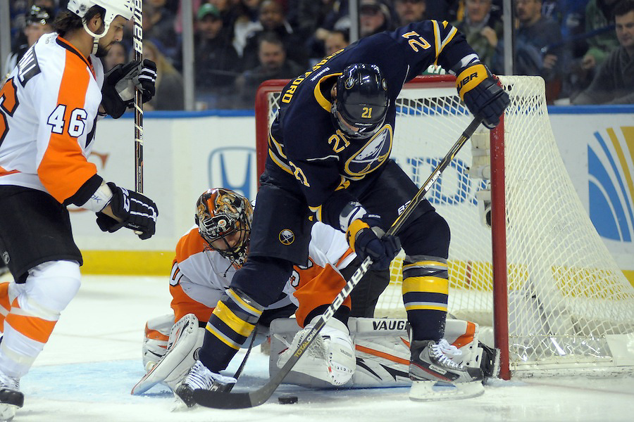 Philadelphia Flyers goalie Ilya Bryzgalov (30) reaches for the puck between the legs of Buffalo Sabres right wing Drew Stafford (21) in the first period at the First Niagara Center in Buffalo, NY. Buffalo leads Philadelphia 3-1 after the first period.