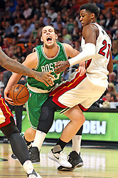 November 28, 2016 - Miami, FL, USA - The Miami Heat's Hassan Whiteside fouls the Boston Celtics' Kelly Olynyk in the first quarter on Monday, Nov. 28, 2016 at the AmericanAirlines Arena in Miami, Fla. (Credit Image: © Charles Trainor Jr/TNS via ZUMA Wire)