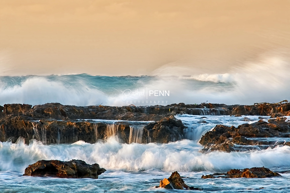 Strong waves bash a rocky beach on New Providence at Delaport beach during sunset.
