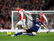 Picture by Andrew Tobin/Focus Images Ltd. 07710 761829. .21/01/12. Phil Jones (4) of Manchester United (R) tackles Aaron Ramsey (16) of Arsenal during the Barclays Premier League match between Arsenal and Manchester United at Emirates Stadium, London.