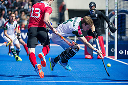 Holcombe's Sam Ward is tackled by David Goodfield of Surbiton. Holcombe v Surbiton - Semi-Final - Men's Hockey League Finals, Lee Valley Hockey & Tennis Centre, London, UK on 22 April 2017. Photo: Simon Parker