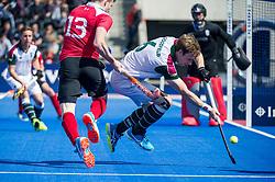 Holcombe's Sam Ward is tackled by David Goodfield of Surbiton. Holcombe v Surbiton - Semi-Final - Men's Hockey League Finals, Lee Valley Hockey & Tennis Centre, London, UK on 22 April 2017. Photo: Simon Parker