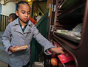 Houston Texans mascot Toro helps serve breakfast at Montgomery Elementary School, March 8, 2016.