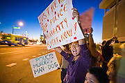 11 OCTOBER 2010 - PHOENIX, AZ:  Children picket Phoenix police headquarters Monday night. About 300 people gathered at the Phoenix Police Department headquarters building Monday night to protest the shooting of Daniel Rodriguez and his dog. The officers responded to a 911 call made by Rodriguez' mother. A scuffle ensued when they arrived and Phoenix police officer Richard Chrisman shot Rodriguez, who was unarmed, and his dog. Chrisman then allegedly filed a false report about the event. He has been arrested on felony assault charges. The event has angered some in the Latino community and they have held a series of protests at the police headquarters. They want Chrisman charged with murder.    Photo by Jack Kurtz