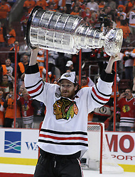 June 9, 2010; Philiadelphia, PA; USA;  Chicago Blackhawks defenseman Duncan Keith (2) raises the Stanley Cup overhead after the Blackhawks defeated the Flyers 4-3 in Game 6 of the Stanley Cup Finals at the Wachovia Center.