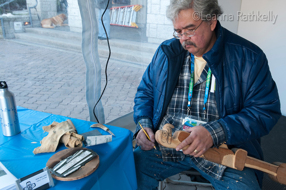 A member of the host first nations, Ron Wallace carves during the 2010 Olympic Winter Games in Whistler, BC Canada.