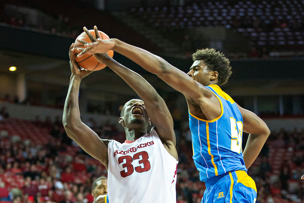 FAYETTEVILLE, AR - NOVEMBER 13:  Moses Kingsley #33 of the Arkansas Razorbacks drives to the basket against Tony Nunn #50 of the Southern University Jaguars at Bud Walton Arena on November 13, 2015 in Fayetteville, Arkansas.  The Razorbacks defeated the Jaguars 86-68.  (Photo by Wesley Hitt/Getty Images) *** Local Caption *** Moses Kingsley; Tony Nunn