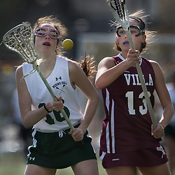 Nerinx Hall's Colleen Meehan (16) and Grace Walsh (13) scrambled for the ball in the first half of a game between Nerinx Hall High School and Villa Duchesne at Nerinx Hall in Webster Groves April 5, 2016. Villa Duchesne won 9-8. Teak Phillips | St. Louis Review