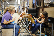 Youth from around the world converged on Oklahoma City for the American Quarter Horse Assocation (AQHA) Youth World horse show at the Oklahoma City Fairgrounds.  Each participant had to qualify either at the state or national level to compete.  All contestants under age 18 and horse must be owned by them or a direct family member...Anna Kapling (left) and Tina Kiensch from Chicago clean a show saddle at the AQHA Youth World Championship horse show.