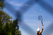Forest Hills Northern's Sara David tosses up a ball to serve in her match against Northview's Abi Howe during the semifinals of the Division 2 regional girls singles tennis tournament at Forest Hills Central High School in Grand Rapids, Mich., on Thursday, May 17, 2018.