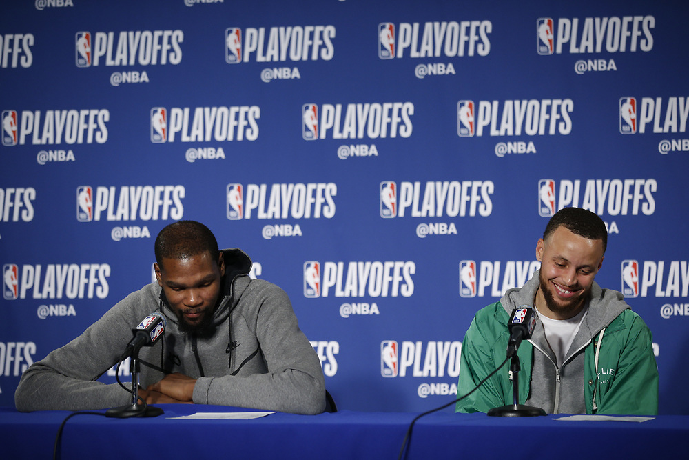 From left: Golden State Warriors Kevin Durant and Stephen Curry during a news conference following Game 2 of the NBA Western Conference semifinals between the Golden State Warriors and New Orleans Pelicans at Oracle Arena, Tuesday, May 1, 2018, in Oakland, Calif. The Warriors won 121-116.