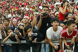 BANGKOK, THAILAND - Thailand. Thursday, July 24, 2003: Thai Liverpool fans watch their heroes take on the Thailand National Team during a preseason friendly match at the Rajamangala National Stadium. (Pic by David Rawcliffe/Propaganda)