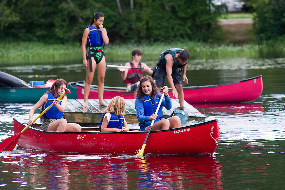 Kids canoeing on Bryant Pond for 4-H camp, Maine