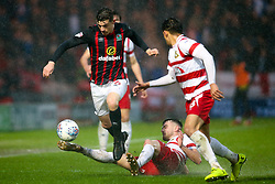 Darragh Lenihan of Blackburn Rovers goes past Ben Whiteman of Doncaster Rovers - Mandatory by-line: Robbie Stephenson/JMP - 24/04/2018 - FOOTBALL - The Keepmoat Stadium - Doncaster, England - Doncaster Rovers v Blackburn Rovers - Sky Bet League One