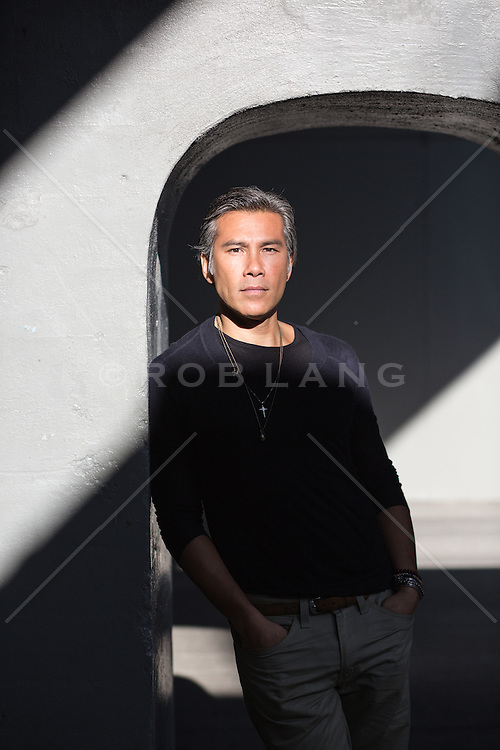 portrait of a middle aged Asian American man