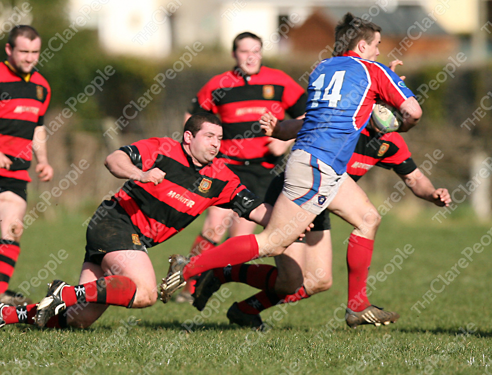 Ennis' 3 tries to stop the advances of UL Bohemians 14 during their game in Ennis on Sunday.<br /> Photograph by Yvonne Vaughan