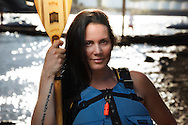 USA, Oregon, Portland, Cathedral Park, woman at Cathedral Park suited up to go paddling. MR