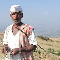 Man with Tobbaco pouch in hand, he was handling his cattles in the field, people here in Sahyadri largely chew tobbaco! MEN, Women even young adults are drwn to tobbaco.