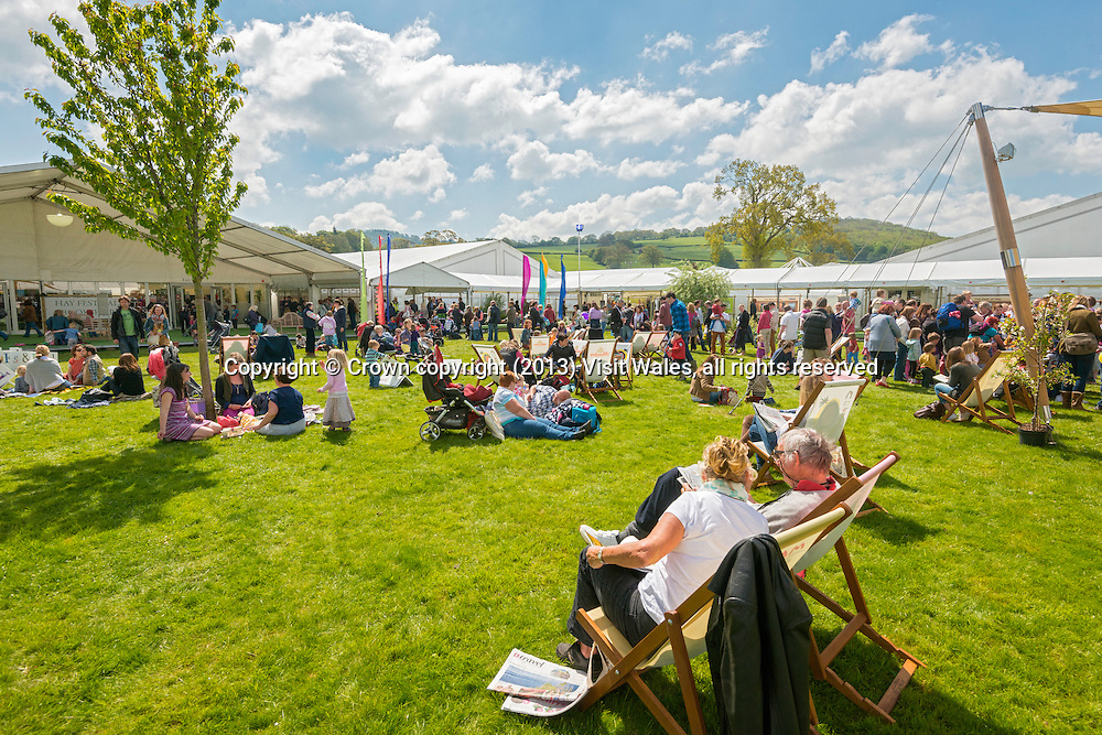 People sitting in deckchairs reading <br /> Hay Literary Festival 2013<br /> Hay-on-Wye<br /> Powys<br /> South<br /> Culture<br /> Arts<br /> Events