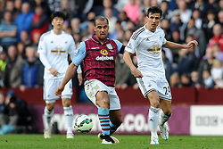 Swansea City's Jack Cork is tackled by Aston Villa's Gabriel Agbonlahor - Photo mandatory by-line: Harry Trump/JMP - Mobile: 07966 386802 - 21/03/15 - SPORT - FOOTBALL - Barclays Premier League - Aston Villa v Swansea City - Villa Park, Birmingham, England.