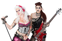 Portrait of punk rock musicians with electric guitar and microphone over white background