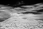 Infrared photograph of desert scrub and Badger Mountain as seen from West Richland, WA.  Fine art photography by Michael Kloth. Black and white infrared photographs