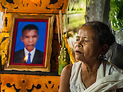 20 JUNE 2016 - DON KHONE, CHAMPASAK, LAOS: A woman at the wake for her husband in their home in Don Khone village on Don Khone Island. Don Khone Island, one of the larger islands in the 4,000 Islands chain on the Mekong River in southern Laos. The island has become a backpacker hot spot, there are lots of guest houses and small restaurants on the north end of the island.     PHOTO BY JACK KURTZ