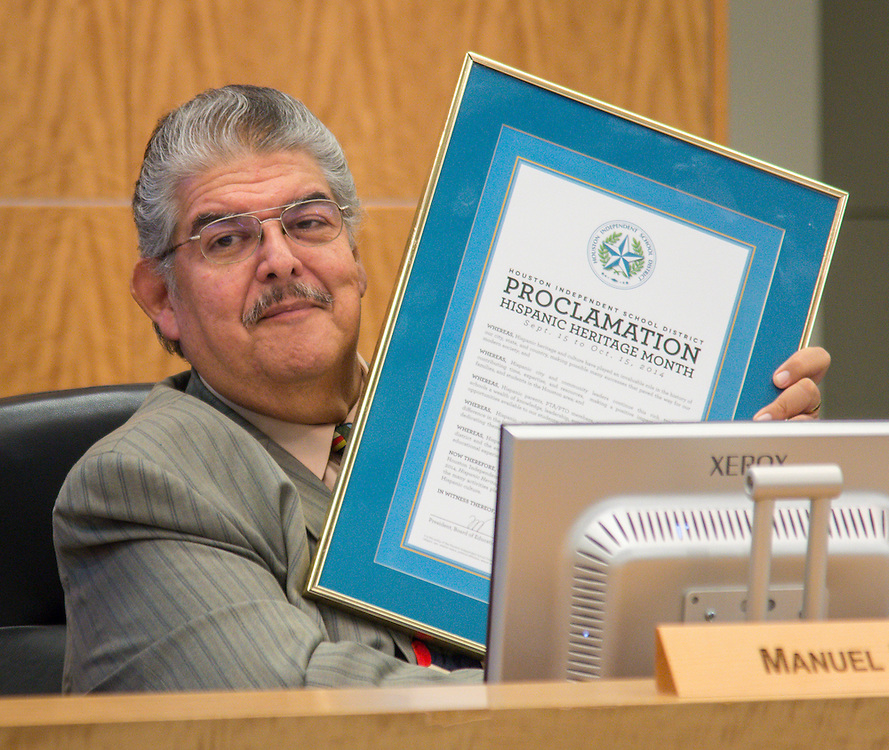Manuel Rodriguez displays a proclamation for Hispanic Heritage Month during a meeting of the Houston ISD Board of Trustees meeting, September 11, 2014.