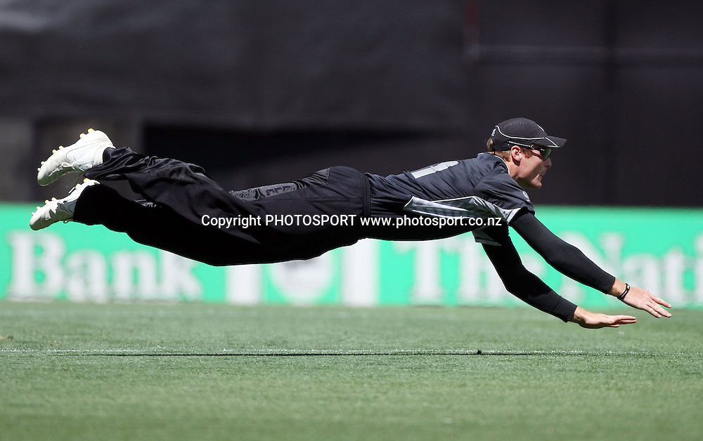 New Zealand fielder Martin Guptill dives fielding as he attempts a run out.<br />