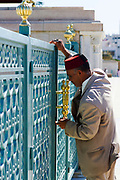 RABAT, MOROCCO - 27th May 2014 - Guardian key keeper opens gated entrance to the Mausoleum of Mohammed V in Yacoub al-Mansour esplanade in Rabat, Morocco.